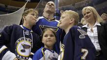St. Louis Blues' Keith Tkachuk, top, watches a video honoring his career alongside his children, from left to right, Matthew, 12, Braeden, 10, and Taryn, 7, and wife Chantal during a ceremony following an NHL hockey game against the Anaheim Ducks Friday, April 9, 2010, in St. Louis. The game was the last for Tkachuk who has announced his retirement after 19 seasons in the league. (AP Photo/Jeff Roberson) (Jeff Roberson)
