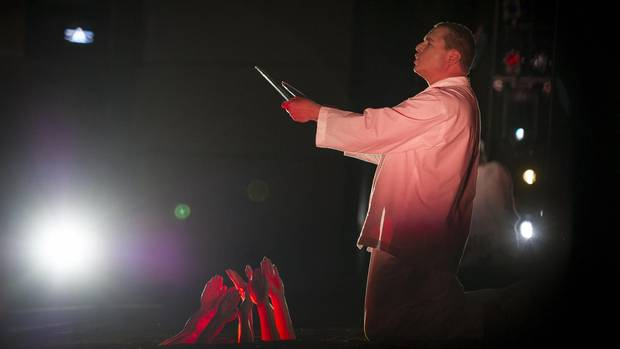 Stefan Vinke, as Siegfried, stands over supers simulating fire.