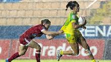 Canadian Kayla Moleschi, left, grabbing hold of Evania Pelite of Australia at the Rio Games, says she's seeing a growing number of girls aged 7 to 17 interested in rugby sevens. (Miguel Schincariol/AFP/Getty Images)