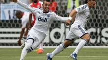 Vancouver Whitecaps' Russell Teibert, left, and Camilo Sanvezzo, of Brazil, celebrate Sanvezzo's goal against the Portland Timbers during the first half of an MLS soccer game in Vancouver, B.C., on Saturday, May 18, 2013. (DARRYL DYCK/THE CANADIAN PRESS)