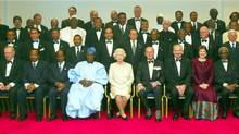 The Queen and the Duke of Edinburgh pose with the Commonwealth heads of government during their meeting in Abuja, Nigeria, in December, 2003.