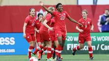 Canada defender Kadeisha Buchanan celebrates her goal with teammates during the first half of play against the United States at Investors Group Field. (Bruce Fedyck/USA Today Sports)