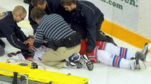 Kitchener Rangers defenceman Ben Fanelli is helped by team trainers and emergency staff after being injured by a hit thrown by Ben Liambas of the Erie Otters on Oct. 30. Liambas has been suspended by the Ontario Hockey League for the remainder of the season. (David Bebee/David Bebee/CP)
