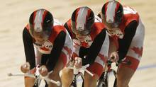 Team Canada's Tara Whitten, Jasmin Glaesser and Gillian Carleton compete to win bronze in the Women's Team Pursuit Final at the 2012 UCI Track Cycling World Championships in Melbourne. (DANIEL MUNOZ/Reuters)