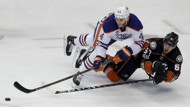 Edmonton Oilers' Zack Kassian and Anaheim Ducks' Rickard Rakell vie for the puck during Game 1 in Anaheim, Calif., on Wednesday.