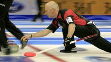Canada skip Glenn Howard delivers his stone during play against France at the World Men's Curling Championship 2012 in Basel March 31, 2012. (ARND WIEGMANN)