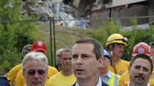 Premier Dalton McGuinty saw the site of a roof collapse for the first time on Wednesday. (Fred Lum/The Globe and Mail)