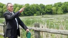 Then-environment minister Peter Kent shows off part of what would be Rouge National Urban Park in Scarborough, Ont., on May 25, 2012. (Nathan Denette/THE CANADIAN PRESS)
