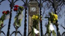 Floral tributes to the victims of the Westminster terrorist attack are placed outside the Palace of Westminster, London, Monday March 27, 2017. (Matt Dunham/AP)