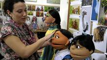 A Pakistani artist gives final touches to characters of Pakistani Sesame Street in Lahore, Pakistan on Oct. 13, 2011. (K.M.Chaudary/K.M.Chaudary/The Associated Press)