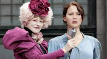 "In this image released by Lionsgate, Elizabeth Banks portrays Effie Trinket, left, and Jennifer Lawrence portrays Katniss Everdeen in a scene from ""The Hunger Games."" (Murray Close/AP2011)"