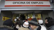 People queue as they wait for a government job centre to open in Madrid on January 22, 2009. The number of unemployed workers in Spain soared to a 12-year high point of more than three million in 2008 as the economy reeled from the collapse of the property market and the global financial crisis. The government called on January 21, 2009 on Spanish shoppers to buy local goods over imports in order to save 120,000 jobs threatened by an expected fall in private consumption in 2009. AFP PHOTO / PHILIPPE DESMAZES (Photo credit should read PHILIPPE DESMAZES/AFP/Getty Images) Philippe Desmazes (PHILIPPE DESMAZES)