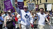 Toronto Maple Leafs General Manager Brian Burke walks with comedian Rick Mercer (R) during the Gay Pride Parade in Toronto, July, 3, 2011. Brian Burke marches in memory of his openly gay son Brendan Burke after he passed away in a car accident last year. (MARK BLINCH/REUTERS)