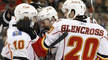 Calgary Flames forward Matt Stajan (C) celebrates his goal against the Toronto Maple Leafs with teammates Niklas Hagman (L) and Curtis Glencross (R) during the third period of their NHL hockey game in Toronto January 15, 2011. REUTERS/Mike Cassese (MIKE CASSESE)