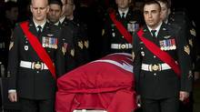 Members of The Royal Canadian Regiment carry the casket at the funeral for Warrant Office Michael Robert McNeil at the Truro Armouries in Truro, N.S. on Thursday, Dec. 5, 2013. McNeil completed several tours of duty including Afghanistan, Bosnia and Croatia. McNeil took his own life late last month at CFB Petawawa. (Andrew Vaughan/THE CANADIAN PRESS)