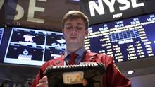 Trader Ryan O'Day works on the floor at the New York Stock Exchange on June 6, 2013. (Brendan McDermid/Reuters)