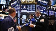 Traders work on the main trading floor of the New York Stock Exchange (NYSE) shortly after the opening bell in New York, May 20, 2013. (Mike Segar/Reuters)