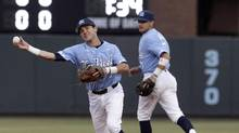 North Carolina shortstop Logan Warmoth throws out a Davidson runner during the first inning of an NCAA college baseball tournament regional game in Chapel Hill, N.C., on June 4, 2017. The Blue Jays selected Warmoth with the 22nd pick in the June draft. (Gerry Broome/THE ASSOCIATED PRESS)