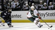 Minnesota Wild right wing Devin Setoguchi skates past San Jose Sharks defenseman Brent Burns (88) during the second period of an NHL hockey game in San Jose, Calif., Thursday, April 18, 2013. Setoguchi was sent to Winnipeg in exchange for a draft pick on July 5, 2013. (Marcio Jose Sanchez/AP)