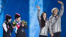 Canadian ice dance partners Tessa Virtue and Scott Moir clap for Americans Charlie White and partner Meryl Davis during the medal ceremony at Sochi Winter Olympics February 18, 2014. (John Lehmann/The Globe and Mail)