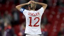 Christine Sinclair leaves the field after Canada's 4 - 3 overtime loss to the United States in semi-final action in Manchester at the 2012 London Olympics. (The Canadian Press)