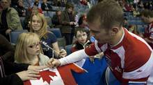 Team Canada skip Jeff Stoughton signs autographs after his teams 7-4 win over Germany at the Brandt Centre during the Ford World Men's Curling Championships in Regina Sunday, April 3, 2011. THE CANADIAN PRESS/Jonathan Hayward (JONATHAN HAYWARD)
