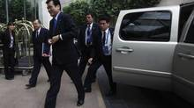 Japan's Finance Minister Koriki Jojima, front, arrives at a hotel in Mexico City, Nov. 4, 2012. The G20 meeting of finance ministers and central bank governors in Mexico will take place from November 4 to 5. (EDGARD GARRIDO/REUTERS)