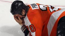 Chris Pronger of the Philadelphia Flyers falls to the ice after being hit in the face by a stick during the game against the Toronto Maple Leafs at Wells Fargo Center on October 24, 2011 in Philadelphia, Pennsylvania. (Bruce Bennett/Getty Images)