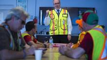 John Horgan, the newly minted B.C. New Democrat Leader, meets union workers during a tour of Western Stevedoring/Lynn Terminal in North Vancouver on May 2, 2014. (John Lehmann/The Globe and Mail)