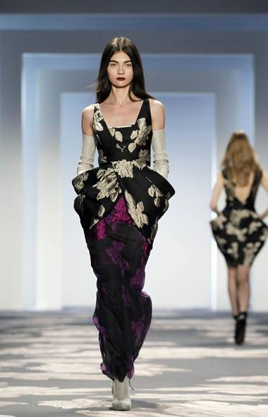 VERA WANG Is Vera Wang the ultimate overachiever? At Tuesday's presentation, she took up collaging - like a boss. The whole thing was a succinct mood board; Stone rose raised jacquards under floating silks bearing the same patterns, print-blocked trousers that made you long for the new and dresses assembled seemingly from different eras and swoops of fabric. I'd love to see her Tumblr. (BRENDAN MCDERMID/REUTERS)