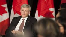 Canadian Prime Minister Stephen Harper is pictured at an economic consultation with Saskatchewan Aboriginal leaders in Saskatoon on Feb. 21, 2013. The Harper government is dismissing a report that ranks it 55th in the world for upholding freedom of information, saying it has a sterling record for openness. (DAVID STOBBE/REUTERS)