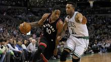 Toronto Raptors guard DeMar DeRozan (10) dribbles the ball as Boston Celtics guard Evan Turner (11) defends during the first half at TD Garden in Boston on Wednesday, March 23, 2016. (Bob DeChiara/USA Today Sports)