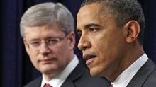 U.S. President Barack Obama and Prime Minister Stephen Harper hold a joint news conference in Washington on Feb. 4, 2011. (JIM YOUNG/REUTERS)