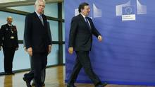 European Commission President President Jose Manuel Barroso walks with Italy's Prime Minister Mario Monti, left, ahead of a European Union leaders summit in Brussels Dec. 13, 2012. (FRANCOIS LENOIR/REUTERS)