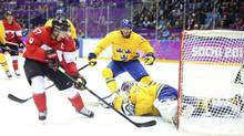 Canadian forward Sidney Crosby (87) scores against Sweden in the second period of the men's gold medal hockey game at Bolshoy Ice Dome during the 2014 Winter Olympics in Sochi, Russia, Feb. 23, 2014. (CHANG W. LEE/NYT)