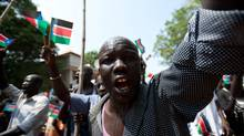 A southern Sudanese man celebrates during a march organised by the Sudan People's Liberation Movement (SPLM) in Juba on July 5, 2011, four days before South Sudan officially declares independence from the north. (PHIL MOORE/AFP/Getty Images)