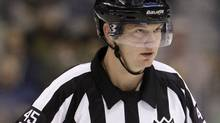 NHL official Marcus Vinnerborg in the first period of an NHL hockey game between the Dallas Stars and Anaheim Ducks Tuesday, Nov. 16, 2010, in Dallas. Some NHL general managers are looking at bringing back the red line as the league's annual meetings approach in Florida. (AP Photo/Tony Gutierrez) (Tony Gutierrez)
