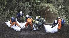 Rescue workers move the bodies of victims of an airplane crash towards a waiting helicopter, in La Union, near Medellin, Colombia, Tuesday, Nov. 29, 2016. The chartered plane was carrying a Brazilian soccer team to the biggest match of its history when it crashed into a Colombian hillside and broke into pieces, Colombian officials said Tuesday. (Fernando Vergara/AP)