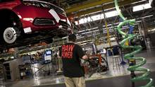 A General Motors employee in Oshawa, Ont., works on an assembly line in 2013. The concept of an auto investment board headed by an industry executive with deep knowledge of the sector was suggested last year by the Canadian Automotive Partnership Council. (Moe Doiron/The Globe and Mail)
