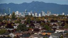 Houses in Arbutus Ridge and the downtown core are pictured in a view from MacKenzie Heights in Vancouver, B.C. (DARRYL DYCK For The Globe and Mail)
