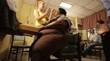Members of Cuban acting troupe Danza Voluminosa at the National Theater in Havana. (REUTERS)