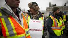 United Truckers Association members protest over rates and wait times outside the Port Metro Vancouver in Vancouver, British Columbia, Monday, March 3, 2014. (Rafal Gerszak for The Globe and Mail)