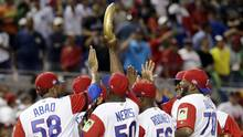Dominican Republic pitcher Hector Neris holds up a replica of a plantain after the Dominican Republic defeated Canada 9-2 in a first-round game of the World Baseball Classic, on March 9, 2017, in Miami. (Lynne Sladky/AP)