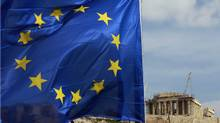 A European Union flag is seen in front of the Parthenon temple in Athens, Feb. 21, 2012. (John Kolesidis/Reuters/John Kolesidis/Reuters)