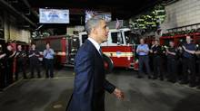 "US President Barack Obama visits of Midtown Firehouse (Engine 54, Ladder 4, Battalion 9) in New York on May 5, 2011 as he arrives to participate in a wreath laying ceremony at the 9/11 Memorial. Obama was Thursday braced for a ""bittersweet"" visit to Ground Zero after the killing of Osama bin Laden, but felt it was important to go to offer ""closure"" to Americans. (JEWEL SAMAD/JEWEL SAMAD/AFP/Getty Images)"