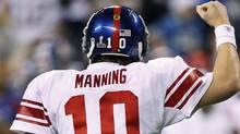 New York Giants quarterback Eli Manning celebrates after throwing a touchdown pass. (AP Photo/Paul Sancya) (Paul Sancya)