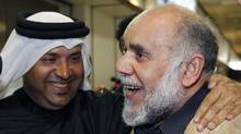 Bahrain Shiite opposition leader Hassan Mushaima is greeted by supporters upon his arrival Saturday at Bahrain International Airport in Manama, the capital. (HAMAD I MOHAMMED/REUTERS)