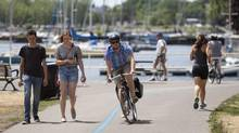 People exercise along Lake Ontario in downtown Toronto on Friday, July 20, 2012. (Matthew Sherwood for/The Globe and Mail)