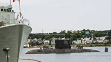 HMCS Windsor, one of Canada's four Victoria-class submarines, heads to dock in Halifax on Friday, July 12, 2013. (Andrew Vaughan/THE CANADIAN PRESS)