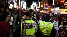 Police officers patrol Granville Street during the Winter Olympic celebrations in Vancouver, BC, February 21, 2010. (Rafal Gerszak/Rafal Gerszak/The Globe and Mail)